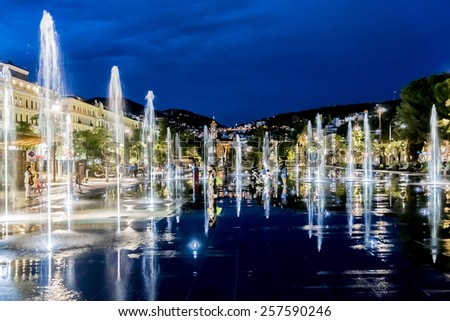 NICE, FRANCE - JULY 7, 2014: Famous Fountain on Place Massena at night. Place Massena - Main Square of the city and it is used for concerts and other events which take place in the city.
