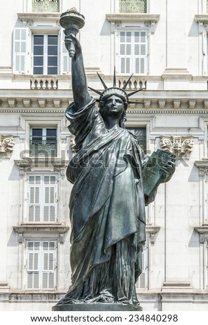 NICE, FRANCE - JULY 11, 2014: View Statue of Liberty. A replica of America\'s most famous monument, Statue of Liberty, is to be installed February 1, 2014 in Nice by Mayor of Nice Christian Estrosi.