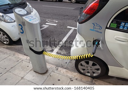 NICE, FRANCE - MAY 1: Electric cars at a charging station on May 1, 2013 in Nice, France.