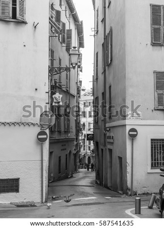 NICE, FRANCE, on JANUARY 8, 2017. The sun lights the picturesque narrow street in the downtown #587541635