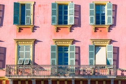 Nice, France, pink facade, with typical windows and shutters