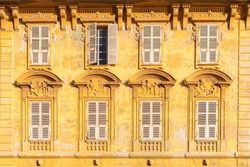 Nice, France, yellow facade, with typical windows and shutters, a vintage building