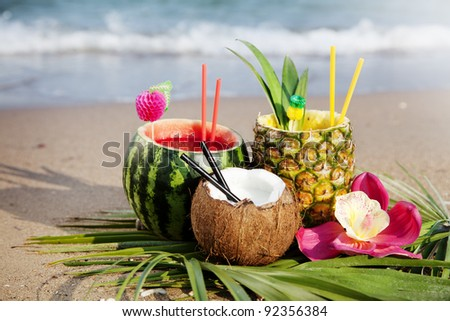 nice fresh exotic cocktails, served on the beach - stock photo