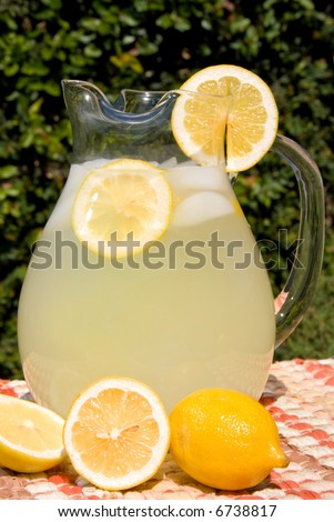 Nice, fresh pitcher of lemonade waiting to be consumed by thirsty picnic goers.