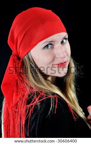 Nice girl in red bandana, on black background
