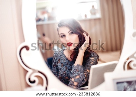 Stock Photo Nice girl in the mirror