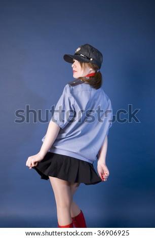 nice girl is sergeant of militia in photographic studio