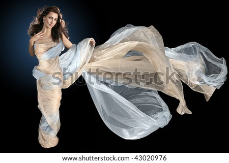 nice girl is wrapped in long silk fabric