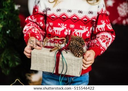 nice girl with Christmas present #515546422