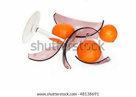 Nice glass broken vase with fragments and tangerines isolated on white background with clipping path
