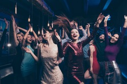 Nice gorgeous lovely chic attractive glamorous cheerful glad positive stylish girls and guys buddy fellow having fun weekend solemn celebratory festive feast in fashionable luxury place nightclub