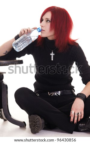 nice gothic girl drinking bottle of  water