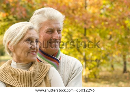nice happy elderly couple in a autumn park