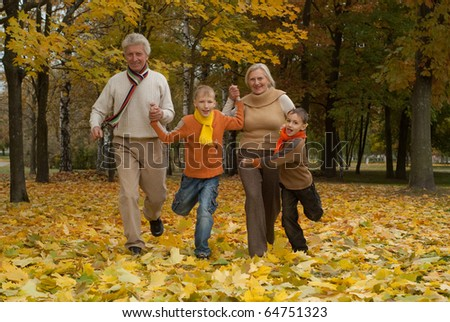 nice happy family of four in a park