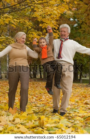 nice happy family of three in a park