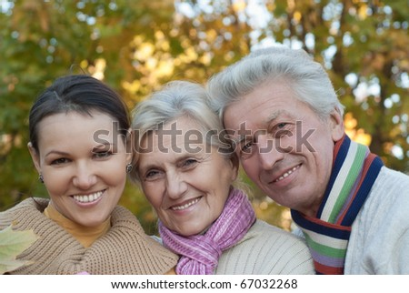 nice happy family of three on the nature