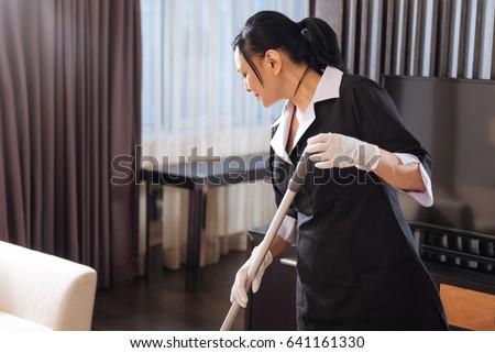 Nice hard working chamber maid looking at the floor Сток-фото ©