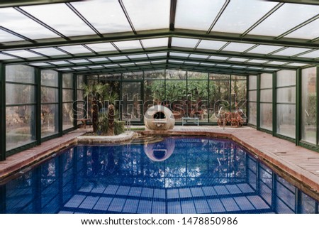 Nice indoor swimming pool view with blue water. summertime, lifestyle indoors #1478850986