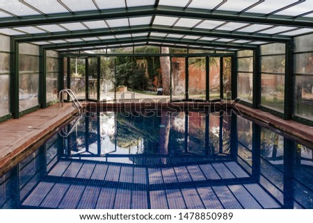 Nice indoor swimming pool view with blue water. summertime, lifestyle indoors #1478850989