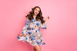 Nice lady overjoyed by warm spring breeze going romantic date wear cute dress isolated pink background