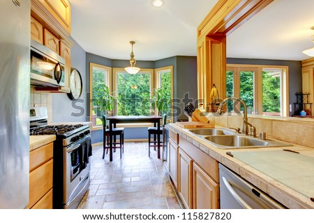 Nice large beautiful wood kitchen with grey walls.