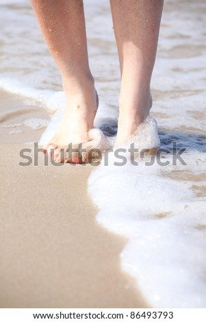 nice legs in water, nice pedicure red nail sand beach