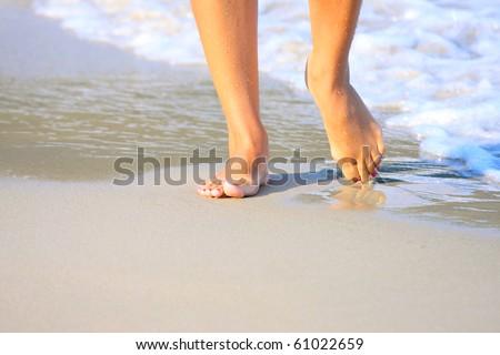 nice legs of a pretty girl walking in water