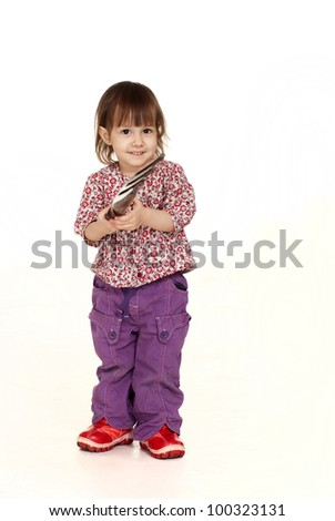 Nice little Caucasian girl posing with a fork on a white background