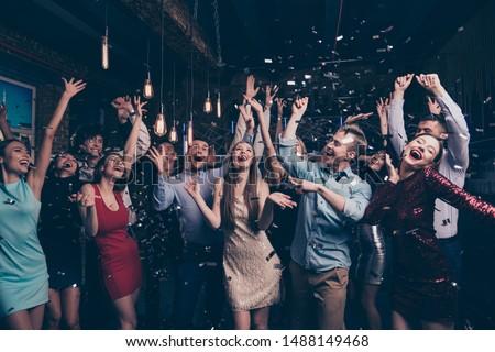 Nice-looking attractive glamorous elegant stylish cheerful positive girls and guys having fun bachelor graduate dream amusement event in fashionable luxury place nightclub indoors