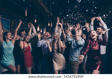 Nice-looking attractive gorgeous glamorous elegant stylish cheerful cheery positive girls and guys having fun bachelor graduate occasion in fashionable luxury place night-club indoors