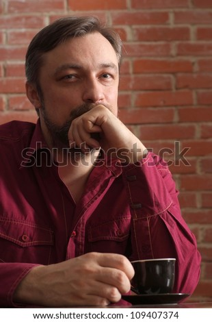 Nice man at home enjoying life to the fullest - stock photo