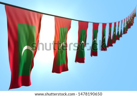 nice many Maldives flags or banners hangs diagonal on rope on blue sky background with soft focus - any holiday flag 3d illustration
