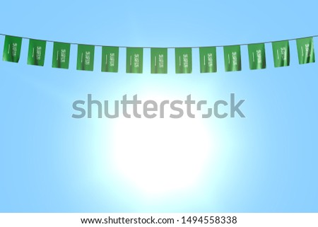 nice many Saudi Arabia flags or banners hangs on string on blue sky background - any celebration flag 3d illustration