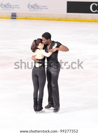 NICE - MARCH 26: Canadian ice dancers Kharis Ralph and Asher Hill skate during official practice at the ISU World Figure Skating Championships on March 26, 2012 in Nice, France