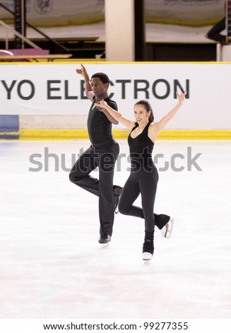 NICE - MARCH 26: Canadian ice dancers Kharis Ralph and Asher Hill skate during official practice at the ISU World Figure Skating Championships on March 26, 2012 in Nice, France - stock photo