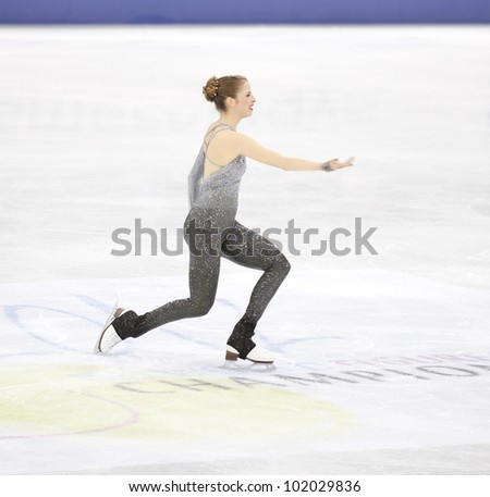 NICE - MARCH 31: Carolina Kostner of Italy takes a bow as she finishes her free skating at the ISU World Figure Skating Championships, held on March 31, 2012 in Nice, France