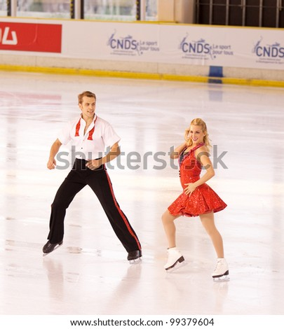 NICE - MARCH 27: Lithuanian ice dancers Isabella Tobias and Deividas Stagniunas skate during official practice at the ISU World Figure Skating Championships, held on March 27, 2012 in Nice, France