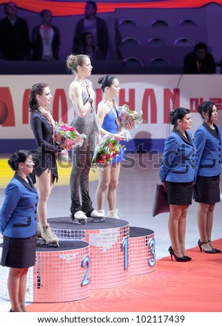 NICE - MARCH 31: Medalists (l-r) Alena Leonova, Carolina Kostner, Akiko Suzuki on the podium during the victory ceremony at the ISU World Figure Skating Championships on March 31, 2012 in Nice, France