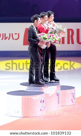 NICE - MARCH 31: Medalists (l-r) Daisuke Takahashi, Patrick Chan, Yuzuru Hanyu on the podium during the victory ceremony at the ISU World Figure Skating Championships on March 31, 2012 in Nice, France