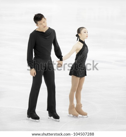 NICE - MARCH 28: Narumi Takahashi and Mervin Tran of Japan perform their short program at the ISU World Figure Skating Championships, held on March 28, 2012 in Nice, France