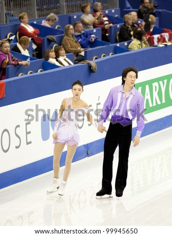 NICE - MARCH 28: Qing Pang and Jian Tong of China take the ice during pairs short program at the ISU World Figure Skating Championships, held on March 28, 2012 in Nice, France - stock photo