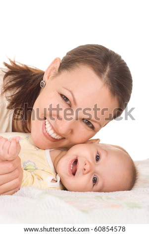 nice mom lie and holds the baby - stock photo
