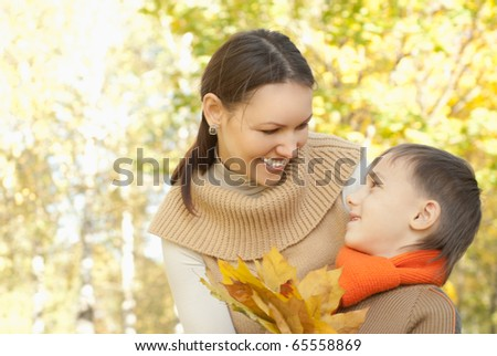 nice mother and son walking in a park