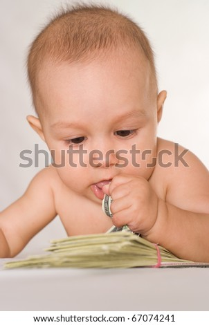 nice newborn and money on a white background