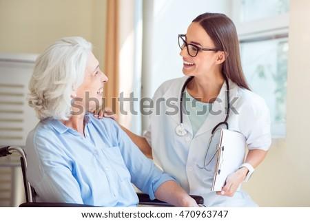 Nice nurse with senior patient
