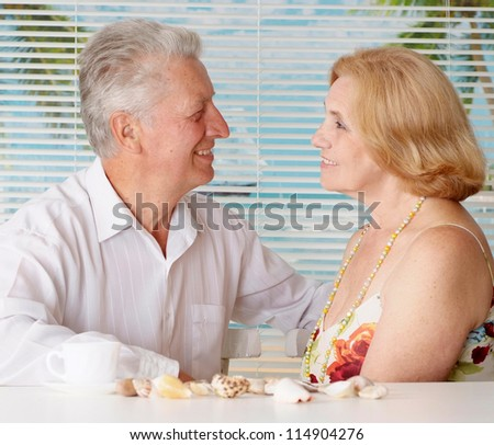Nice old  couple went to a resort vacation