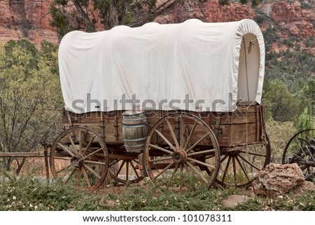 Nice old covered wagon in Arizona, red rock background