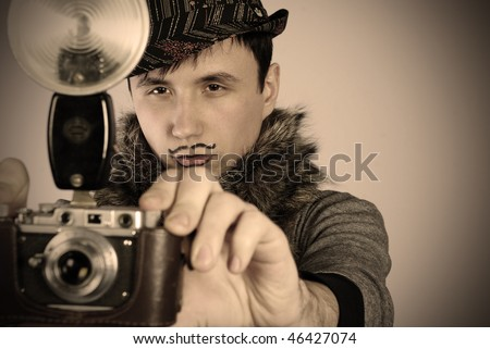 nice photographer with vintage film camera