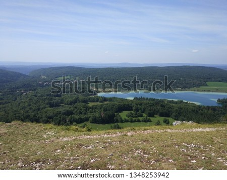 "Nice Point of view on beautiful blue lake in ""le pic de l'aigle"" in jura"