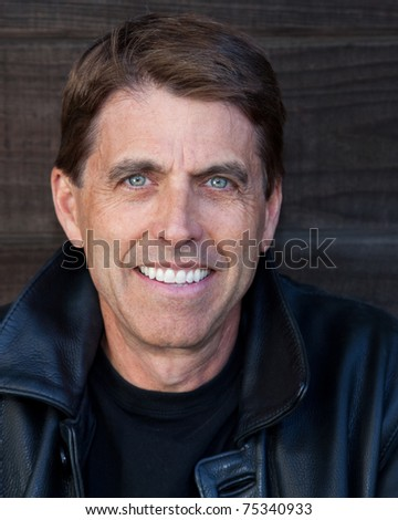 Nice portrait of a happy man in an outdoor setting.